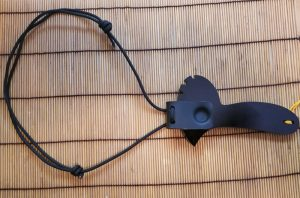 Solo holster using a neck rig attached to a defender 1